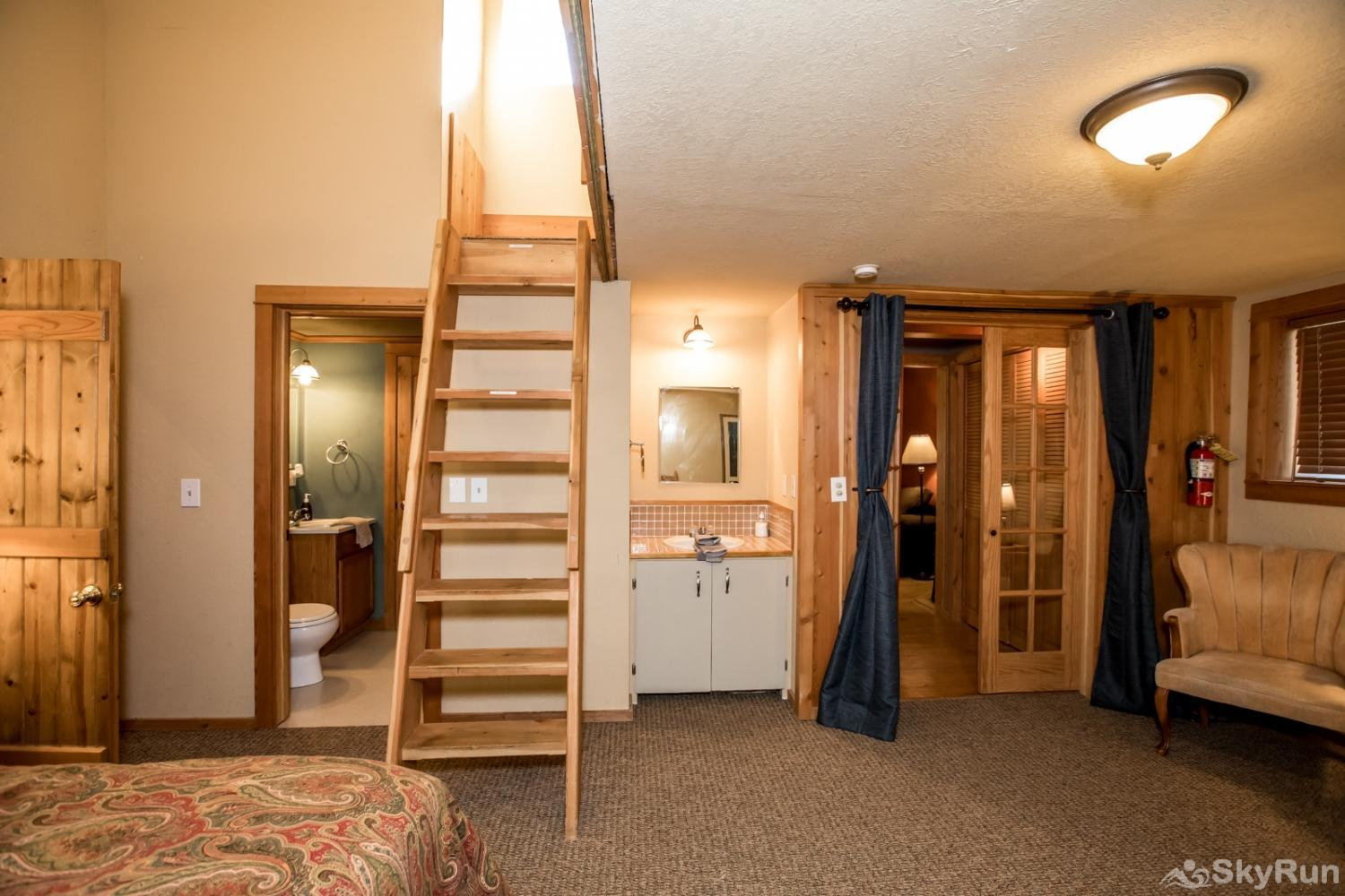 The Great House at Stillwater Mountain Lodge Third bedroom with queen bed and ladder to the loft