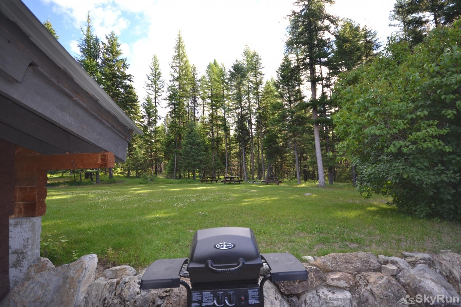 The Great House at Stillwater Mountain Lodge Shared Gas grill over looking the fire pit and picnic tables