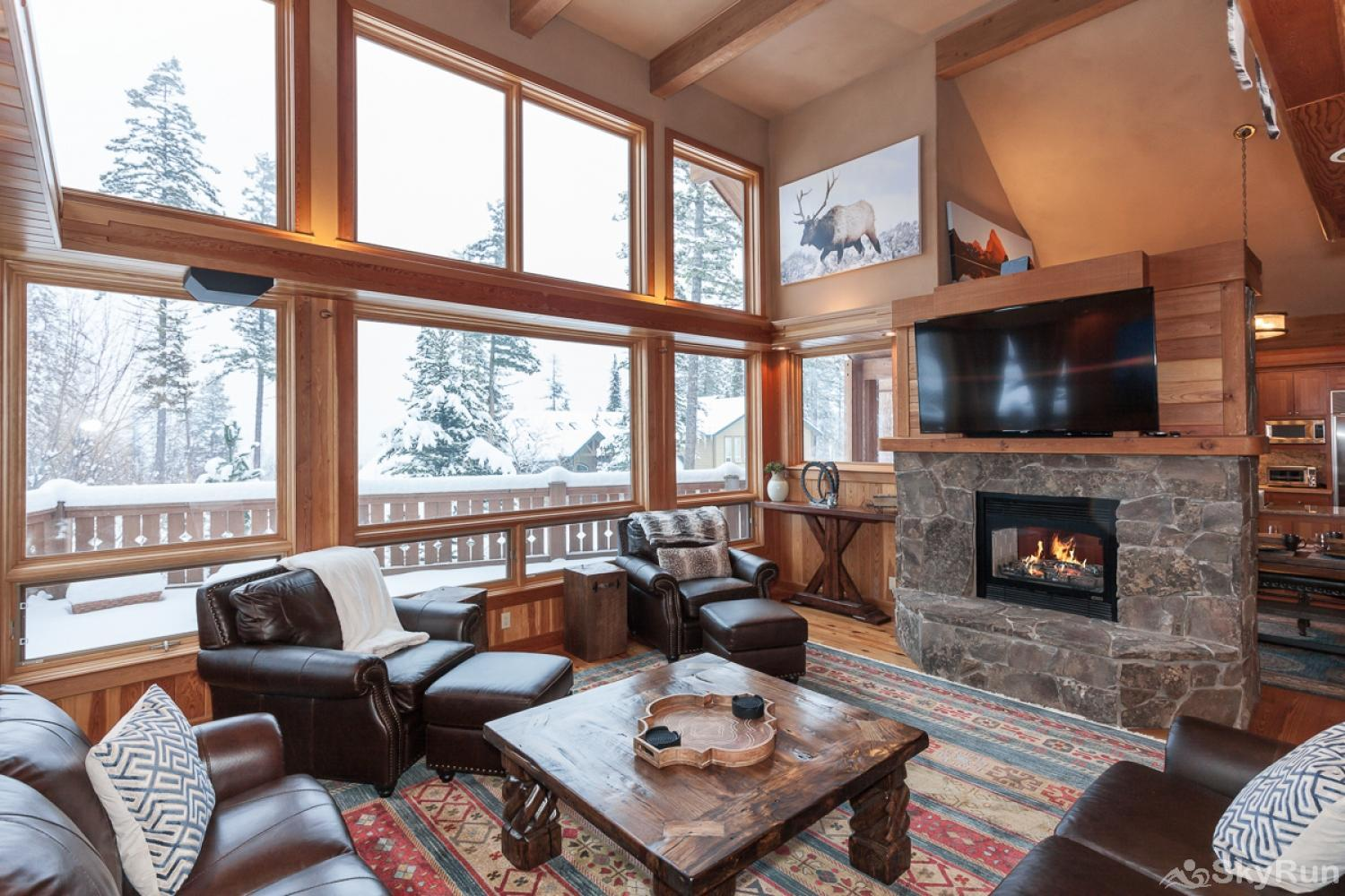 Highland Huckleberry Lodge Relax and unwind in the living room while enjoying the fire, TV and picture windows with views of the ski runs
