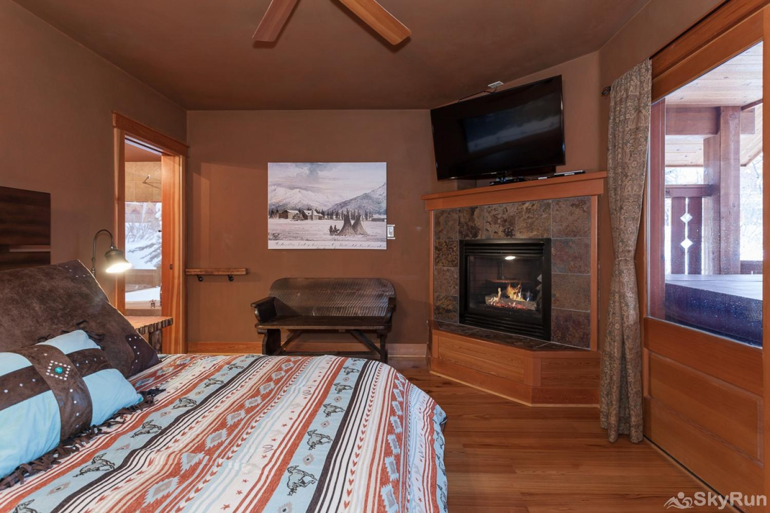 Highland Huckleberry Lodge The Bison Suite's creature comforts include a new TV and fireplace