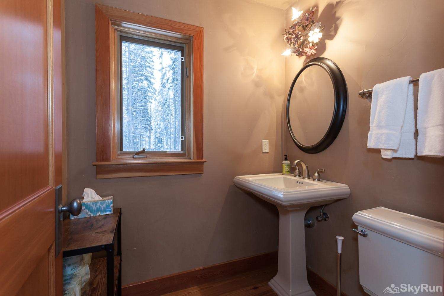 Highland Huckleberry Lodge Half bath is located on the main floor just off of the living and dining room