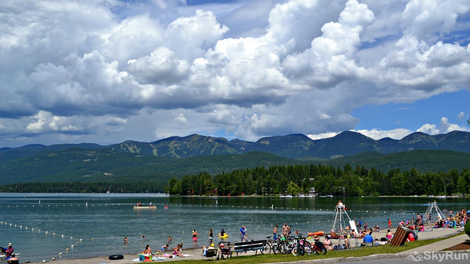 Highland Huckleberry Lodge In the summer enjoy Whitefish City Beach with stunning mountain views