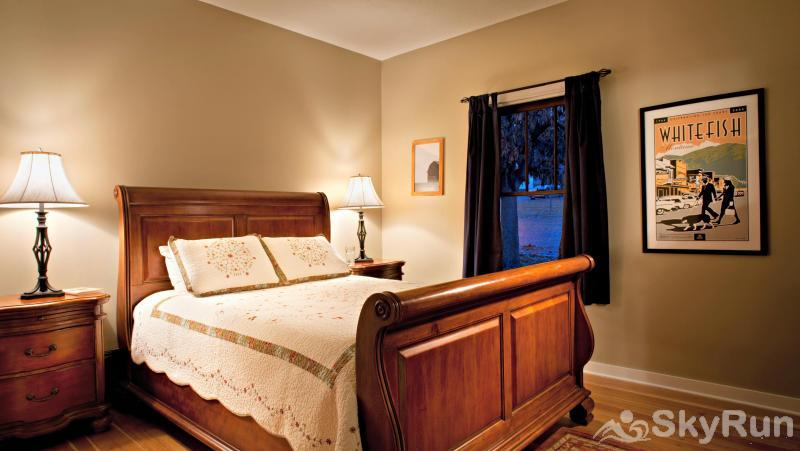 The Clayton House Downstairs Bedroom with Queen Bed
